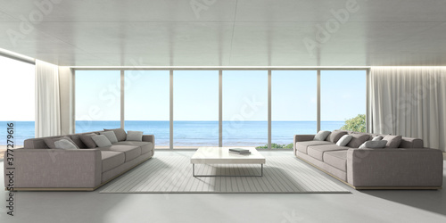 Obraz 3d render of modern living room with concrete floor and sofa on sea background, large window panel. - fototapety do salonu