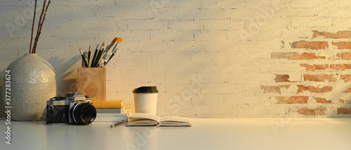 Worktable with stationery, camera, decorations and copy space in home office Canvas Print