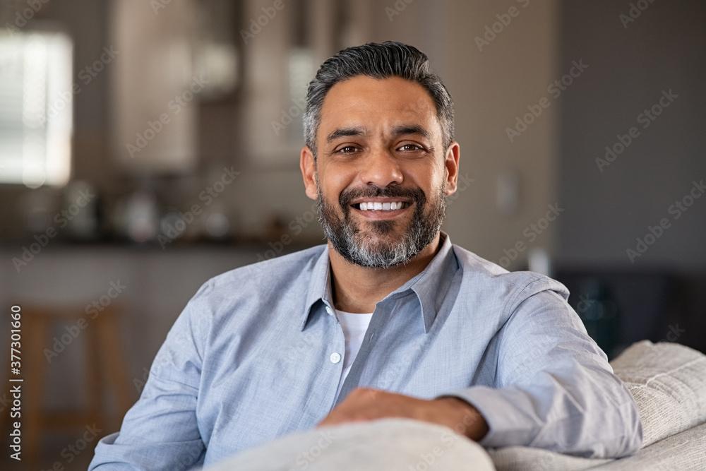 Fototapeta Portrait of happy indian man smiling at home