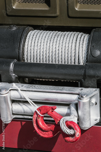 Foto winch with a cable for self-hauling is installed on a truck or passenger car