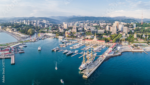 Obraz Aerial photography. The black sea coast of Russia, the city of Sochi, seaport, yachts and ships at the pier. City attraction - fototapety do salonu
