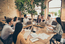 Photo Of Business Men Ladies People Partners Sitting Around Table Desktop Spacious Big Office Seven Members Successful Professionals Good Mood Discussing New Project Indoors