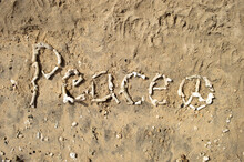"""""""Peace"""" Word Made With Coral On The Sand"""