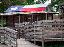 Texas Flag Painted On The Tin Roof Of Country Shack