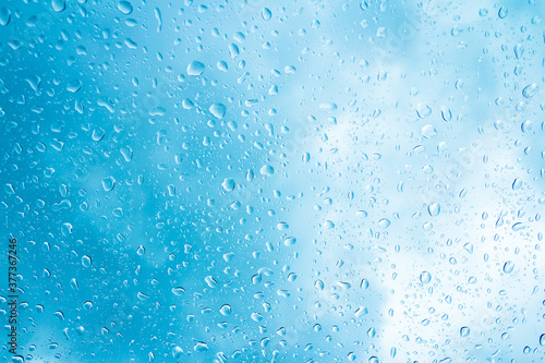 Fototapety, obrazy: Blue water drops on glass or rain drop background