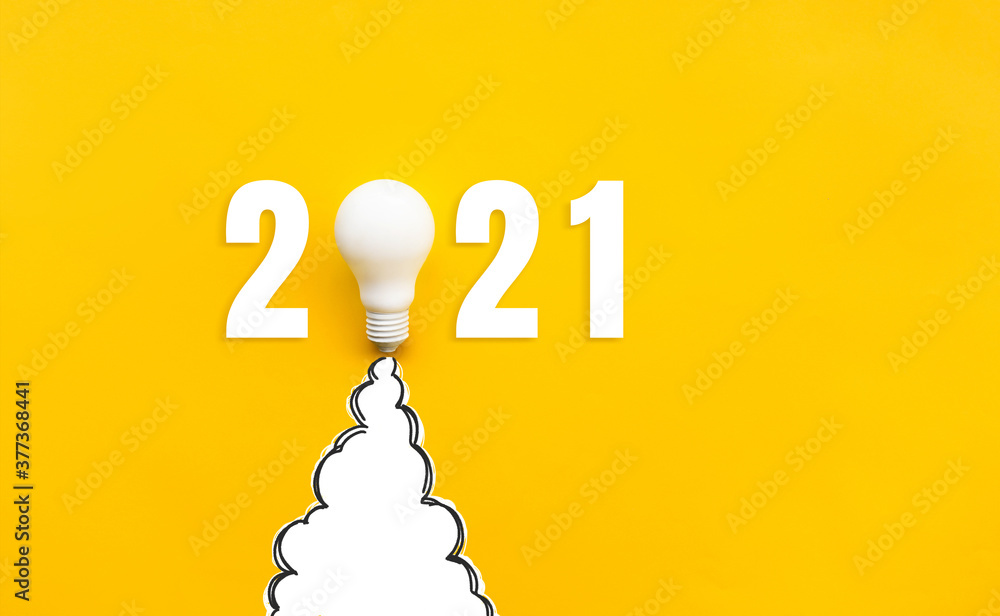 Fototapeta New year 2021 Ideas,inspiration concepts with rocket light bulb on yellow background