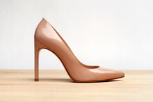 Fashion High Heels Women Shoes Beige Color. Stiletto Shoe Style In Ladies Wardrobe. High Fashion And Formal Female Accessory.