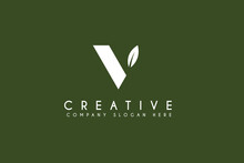 Initial Letter V Logo Design With Natural Leaf.vector Business And Branding Logo Isolated On Green Background