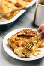 Fork Taking A Bite Of Apple Cinnamon Bread Pudding