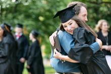 Grad: Proud Parent Hugs New Gr...