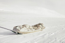 Vintage Army Sled In White Winter Landscape
