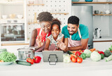 Fototapeta Łazienka - family child kitchen food daughter mother father cooking preparing tablet video call waving  happy together