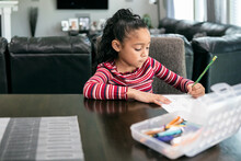 Home: Young Girl Does Schoolwork At Home During Pandemic