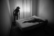 Woman Sweeping Bedroom Floor