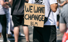 BLM: We Want Change Sign On Back Of Protester