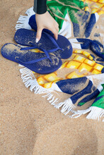 Flip Flops And Towel On The Beach