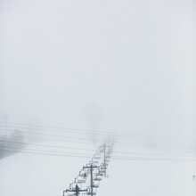 A Ski Resort In The Snow And Fog