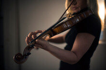 A Beautiful Woman Plays The Vi...