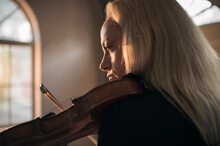 A Beautiful Woman Plays The Violin