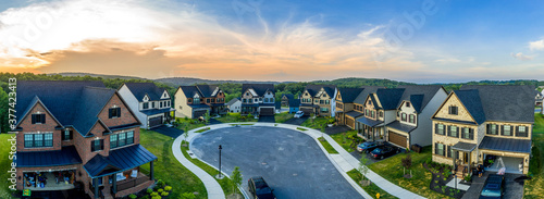 Fotografia Aerial sunset panoramic view of newly built high end luxury single family alp st