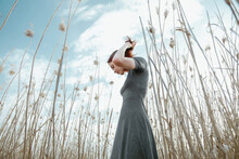 Beautiful Girl In A Field With Tall Grass