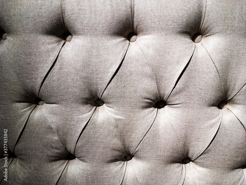 Obraz na plátně Capitoné gris con textura de tela