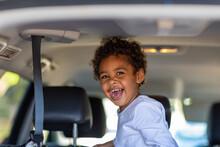 Happy Little Kid In Back Of A ...