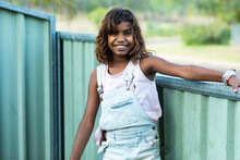 Young Girl Outside Near Fence ...