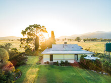 Sunlight Shining Over Farm Homestead In Morning, Grass Is Green After Rain