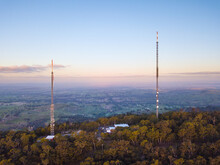 Aerial View Of Two Large Antennae On The Top Of A Hill