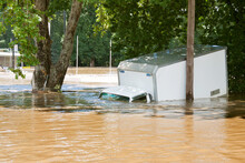 A Delivery Truck Half Submerge...