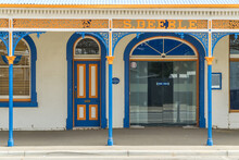 A Brightly Painted Old Shop Front And Veranda