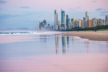 Hi Rise Buildings On The Gold Coast Reflected On A Wet Sandy Beach At Twilight