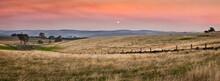 The Sun Setting Into A Smoke Filled Sky Over Dry Farmland