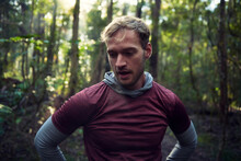 Male Runner Paused For A Breather In The Woods