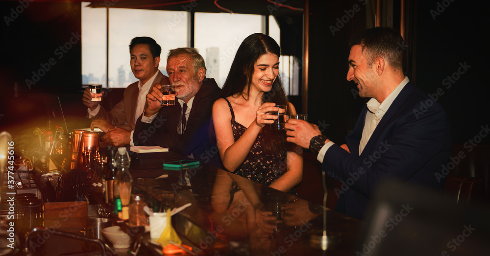 Fototapeta businesspeople toasting glasses of whiskey to celebrate friendship