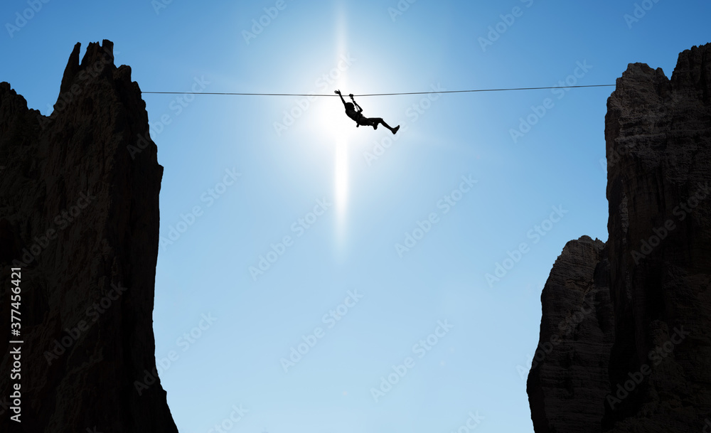 Fototapeta Man balancing on the rope concept of challenge and risk taking