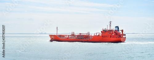 Large red cargo ship (tanker) sailing near Vlissingen, the Netherlands Canvas Print