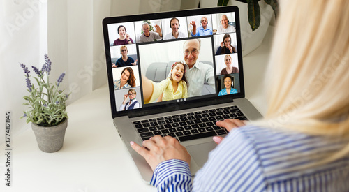 Fototapeta Many portraits faces of diverse young and aged people webcam view, while engaged in videoconference on-line meeting. Group video call application easy usage concept obraz na płótnie
