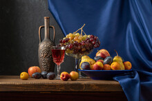 Still Life With Fruit And A Bottle Of Wine. Apples, Pears, Plums, Grapes And Nectarines.