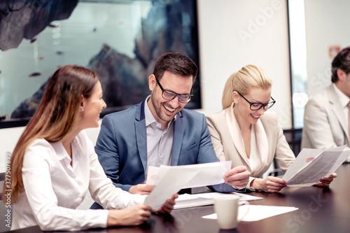 Fototapeta Three business people working at meeting obraz na płótnie
