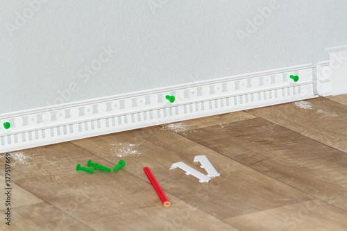 plastic white floor plinth installation. #377517669