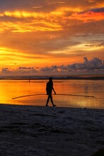 Silhouette Of A Person On The Beach At Sunset