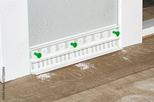plastic white floor plinth installation #377520454