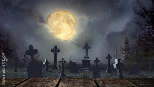 Wooden surface and moonlit graveyard with old creepy headstones on Halloween Canvas-taulu