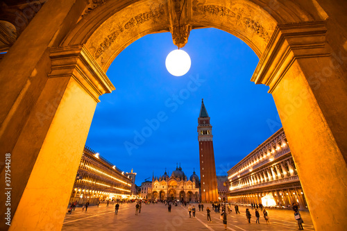 Fotografie, Obraz San Marco sqaure and Campanile tower in Venice at night, Italy