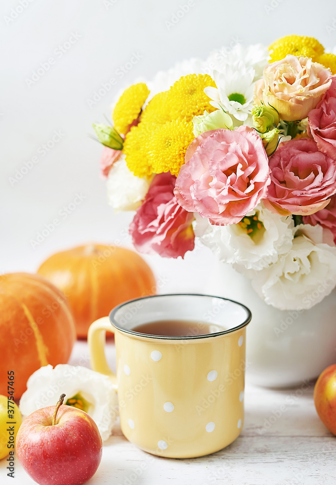 Fototapeta Autumn harvest pumpkin background. Pumpkins, apples and flowers on table. Thanksgiving table. Copy space. Halloween or seasonal autumnal. Design mock up. Greeting card. Fall kitchen.