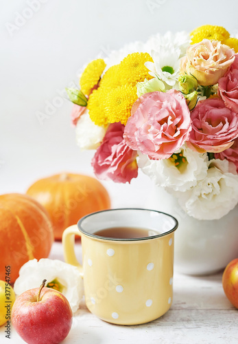 Fototapeta Autumn harvest pumpkin background. Pumpkins, apples and flowers on table. Thanksgiving table. Copy space. Halloween or seasonal autumnal. Design mock up. Greeting card. Fall kitchen. obraz