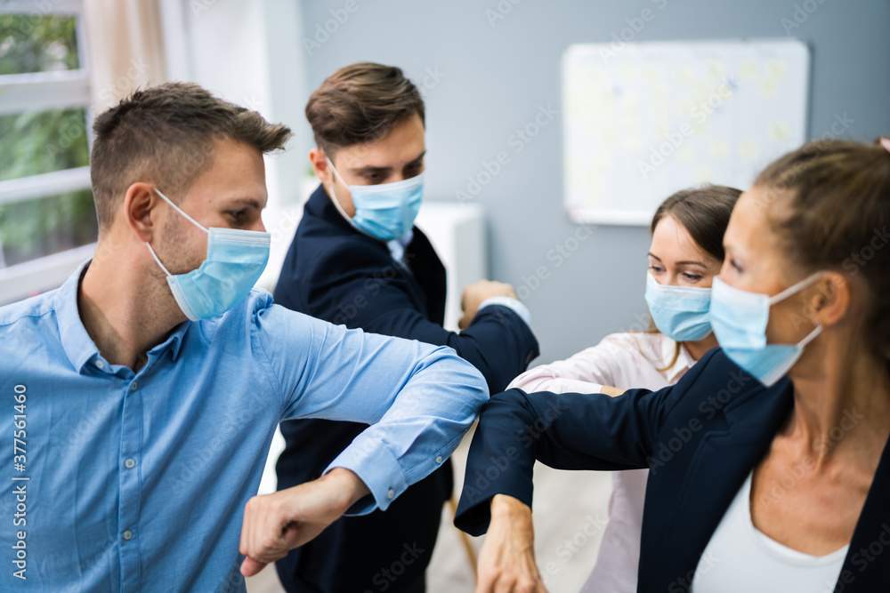 Fototapeta Employee Doing Elbow Bump To Avoid Flu