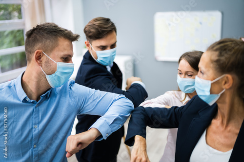 Employee Doing Elbow Bump To Avoid Flu - 377561460